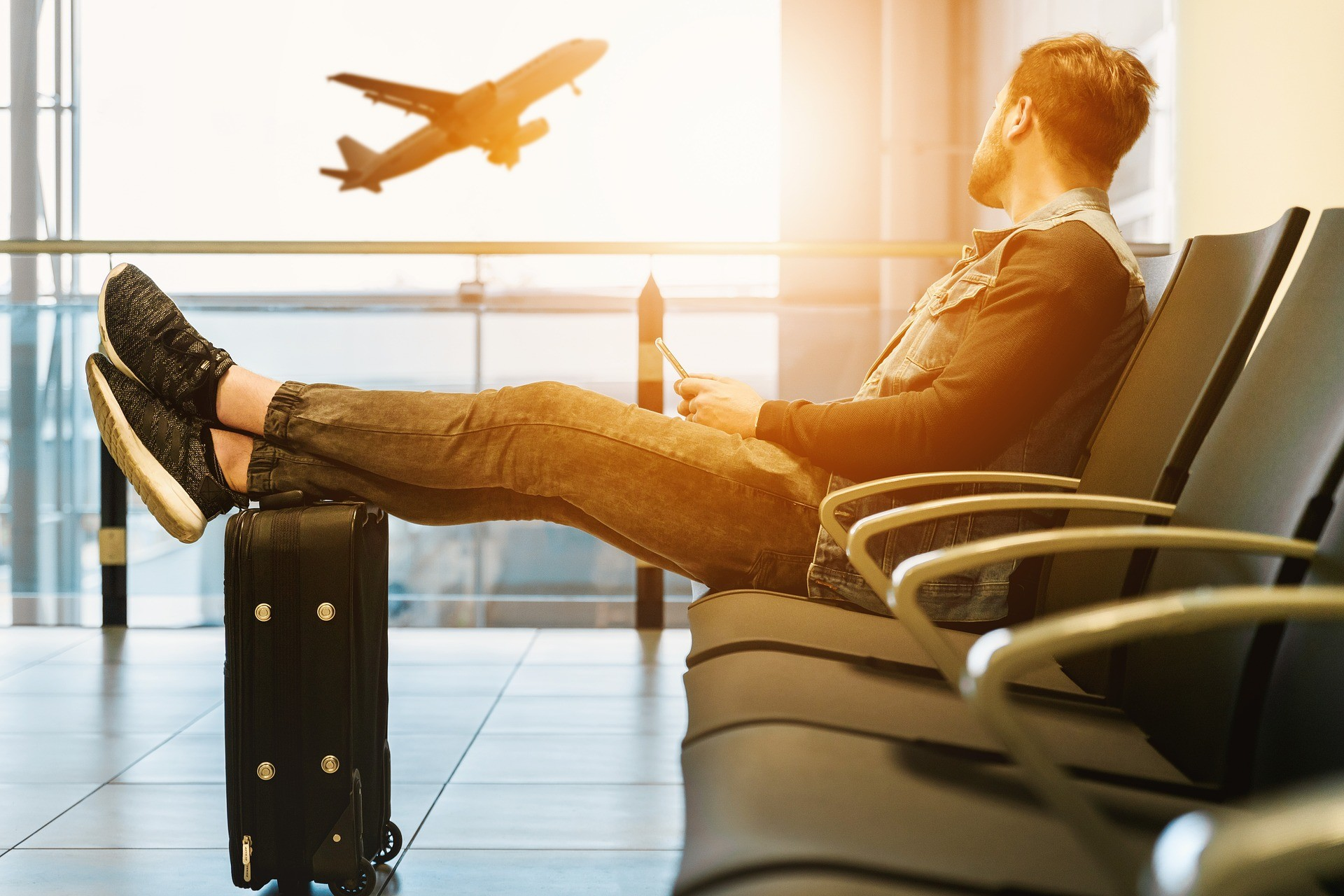 man sitting in airport lounge