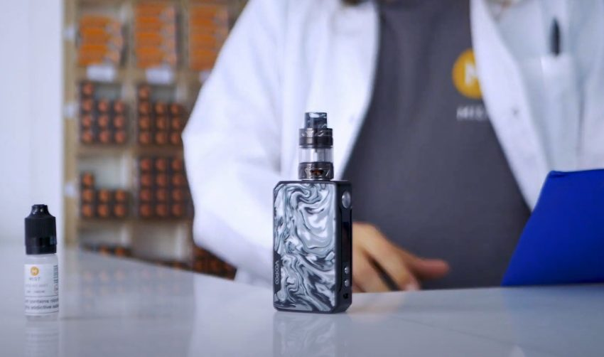 A picture of vaporesso vape kit with a bottle of nic salt