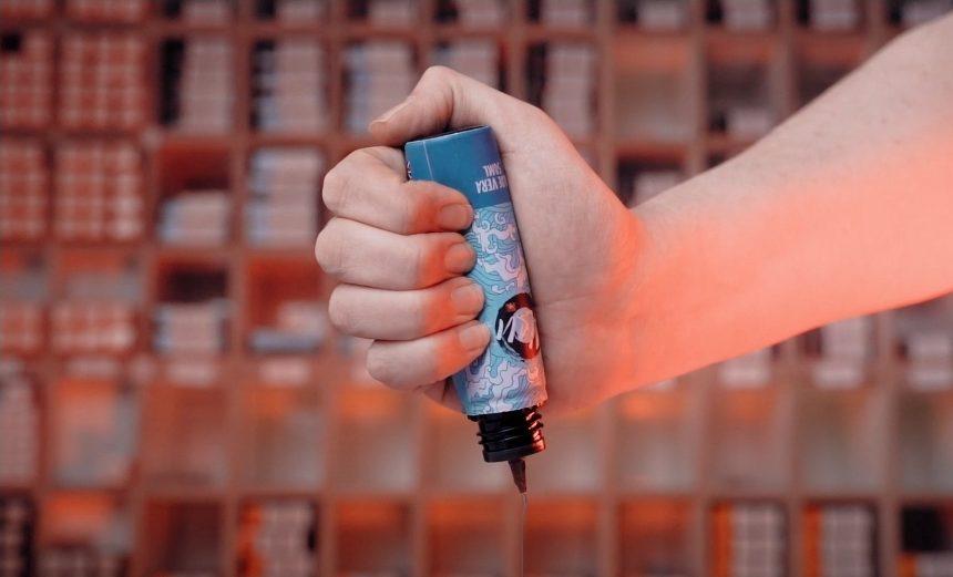 Man squeezing a vape juice bottle
