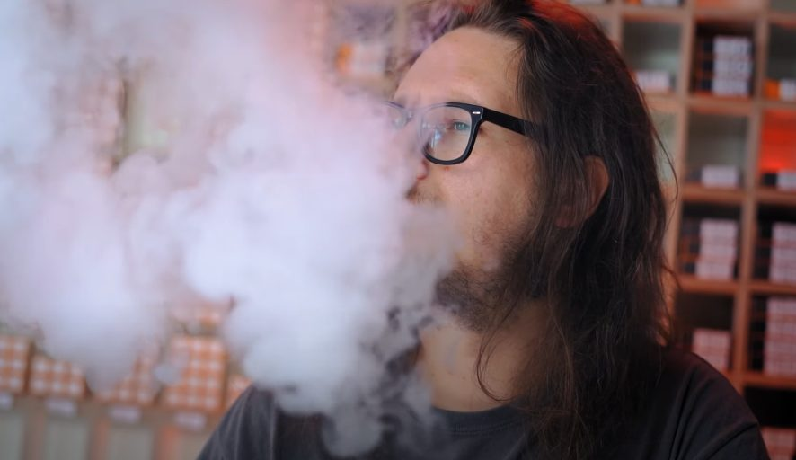A picture of a man vaping
