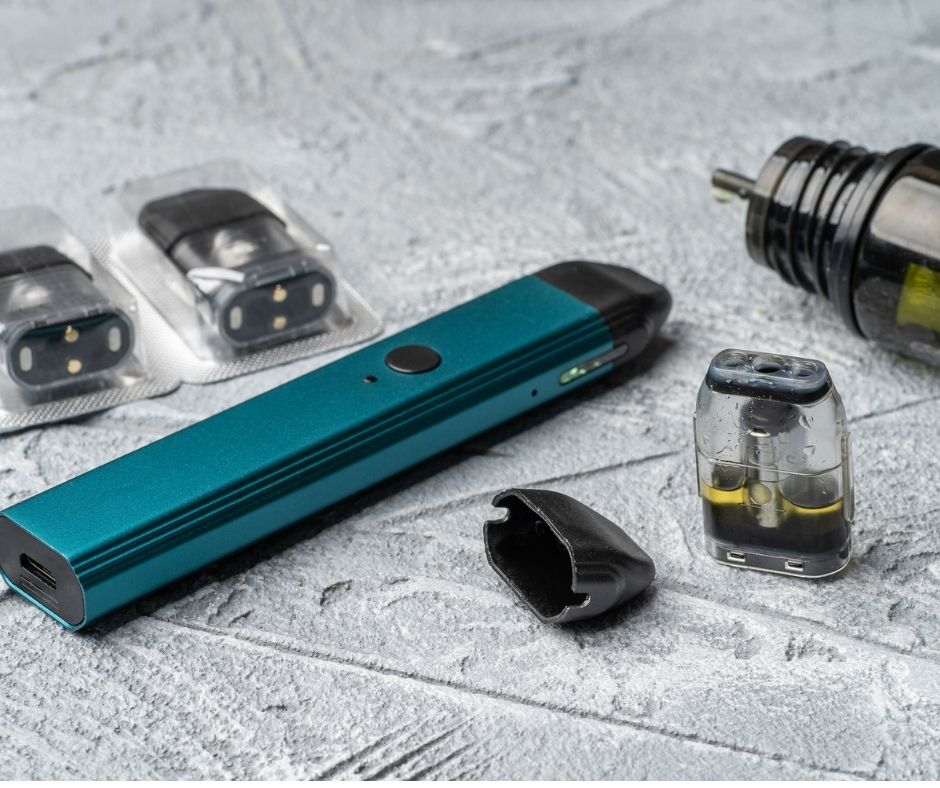 Picture of caliburn vape pod with eliquid and extra pods