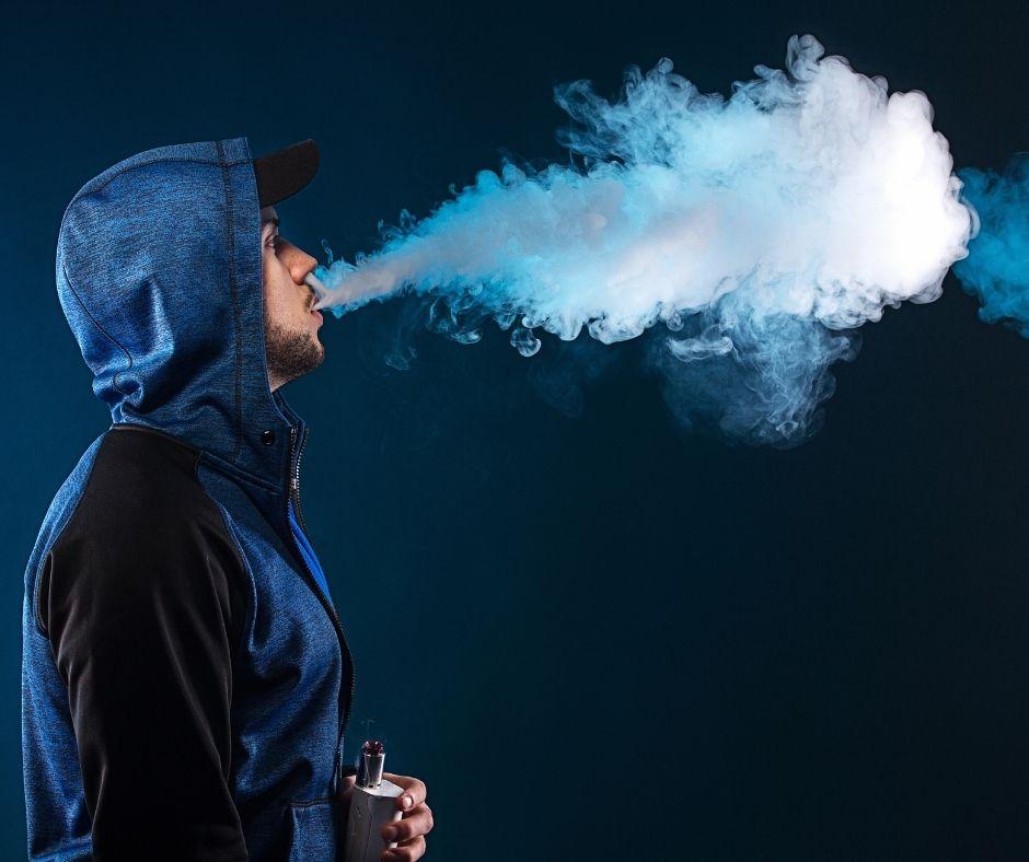 man exhaling huge vape clouds