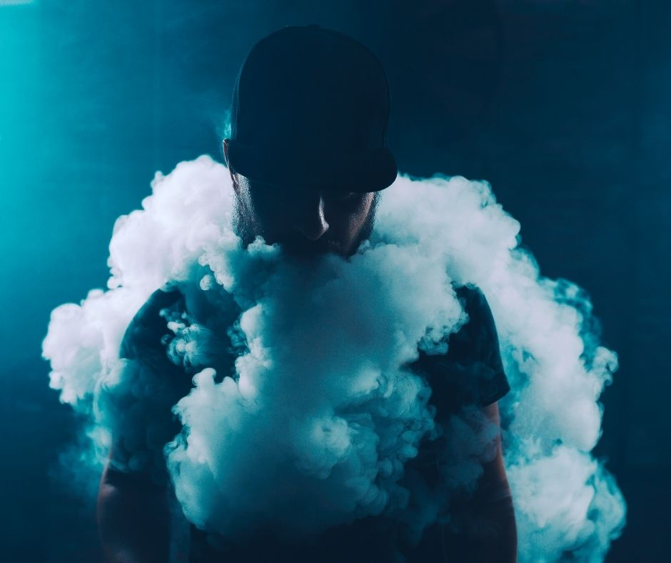 man producing huge vape clouds